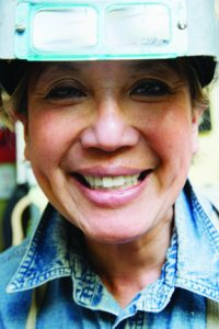 Portrait of female welder