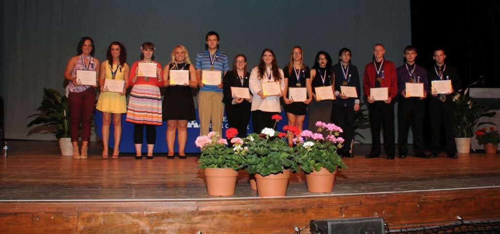 Photo of seniors receiving principal's awards at Palace Theatre.