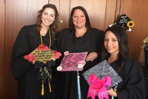 Tri-Rivers Nursing graduates show off their decorated caps.
