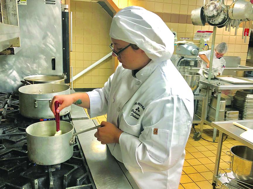 Culinary Arts student at stove