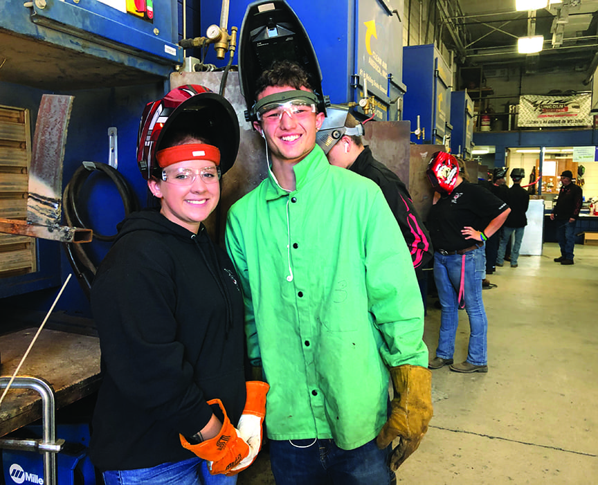 Welding students with Instructor